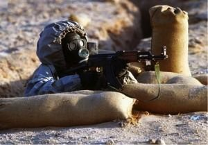A Syrian soldier outfitted in Soviet era chemical warfare gear during a training exercise in 2010