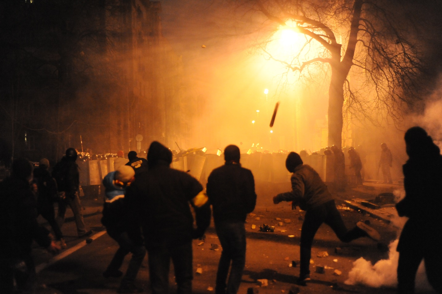 Protestors launch any available projectiles at walls of riot police on a smoky January night in Ukraine. (Wikimedia Commons)