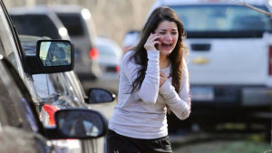 Carlee Soto tries to get information on her sister, Victoria Soto, a victim of the Sandy Hook shooting. (Photo Credit: AP Photo/Jessica Hill)