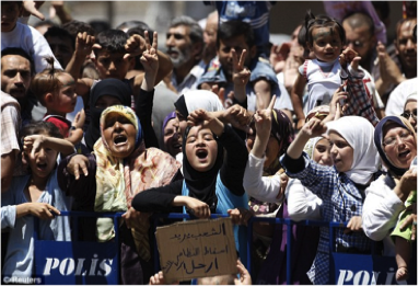 Syrians protest against Assad in 2011 (Photo Credit: Reuters)