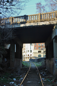 A view of 909 Broad's entrance through a nearby railroad tunnel.