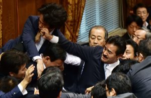 Members of the House of Councillors fighting over a motion to allow Japanese troops to go overseas. Credit: PUCP
