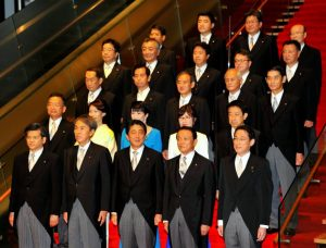 PM Shinzo Abe (first row, center) with his cabinet. Minister of Defense Tomomi Inada is in the second row, second from right. Credit: Japan Times