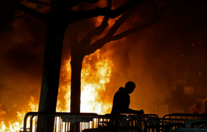 Protestors lighting fires resulting in property damage to the UC Berkeley campus Source: New York Times