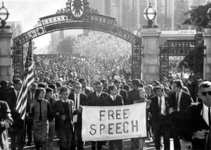 "Massive student protests erupted across campus at Berkeley in 1964 with the aim of getting the university to ""lift the ban off of on-campus political activities and acknowledge the students' right to free speech and academic freedom."" Source: The Berkeley Byte"