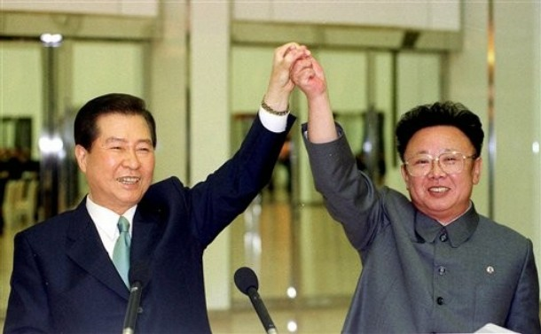 North Korean leader Kim Jong Il, right, and South Korean President Kim Dae-jung sign a joint declaration at a three day summit in Pyongyang on June 14, 2000, as part of Dae-jung's Sunshine Policy  Source: AP Photo/Yonhap, Pool